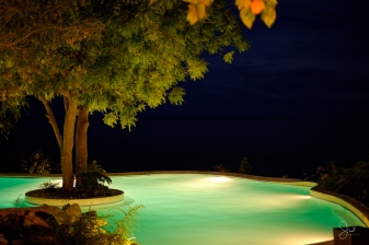 the pool all lit up at night